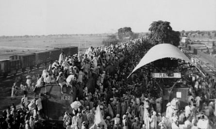 Muslim refugees sit on the roof of an overcrowded coach railway train near New Delhi in trying to flee India, September 1947.