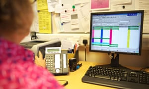 A receptionist in a GP surgery books appointments by phone and online.
