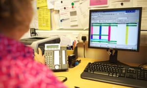 Female receptionist in a large GP's surgery