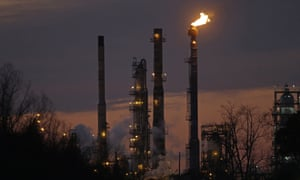 Stacks and burn-off from the Exxon Mobil refinery, at dusk in St Bernard Parish, Louisiana.