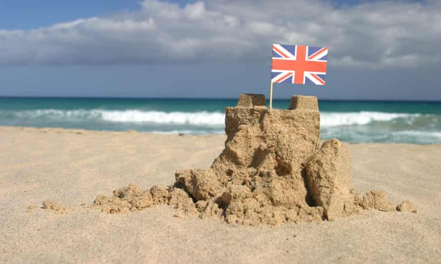 A sandcastle with a British flag in the Canary Islands, Spain.