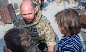 British soldier with children