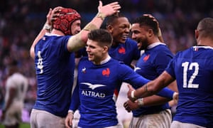 France's players celebrate at the final whistle.