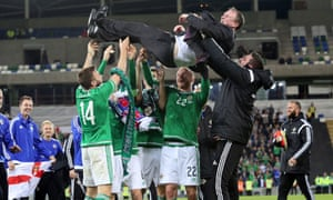 Northern Ireland players lift manager Michael O'Neill
