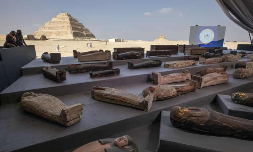 People look at ancient sarcophagi on display, discovered in a vast necropolis in Saqqara, Giza, Egypt