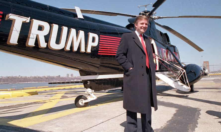 Donald Trump poses in front of a helicopter in 1988.