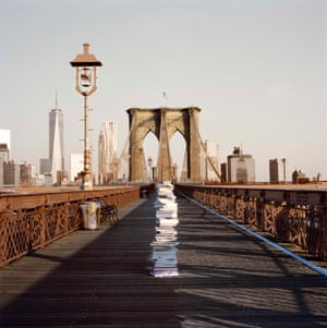 stack of books on Brooklyn Bridge