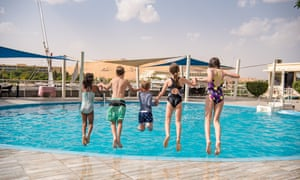 The kids jumping into the pool in their Nile-side Aswan hotel.