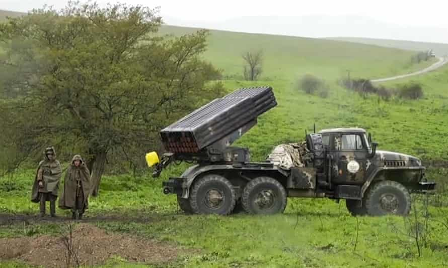 A TV screengrab shows Armenian soldiers alongside a Grad rocket launcher in the Nagorno-Karabakh region