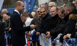 Prince William speaks to Leicester City supporters during the visit