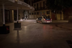People run away from police after curfew in Barcelona, Spain