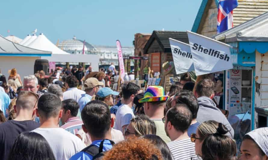 Queue for snacks on Brighton beach, England, during the recent bank holiday.