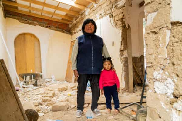 Gabriela Laruta, daughter of ASITURSO founder Tomas Laruta, with her niece at her father's house, which the family is converting into bedrooms for tourists who they hope will come for homestays in the community.