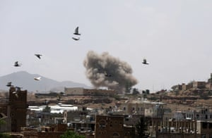 Dust rises from the site of a Saudi-led air strike in Sana'a, Yemen, on 30 March.