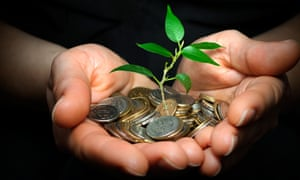 Person holding plant sprouting from a handful of coins