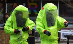 Members of the emergency services in green biohazard encapsulated suits work at the bench in Salisbury where former Russian spy Sergei Skripal and his daughter Yulia were found in critical condition.