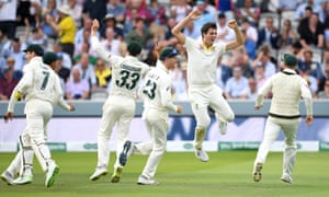 Pat Cummins of Australia celebrates with teammates after dismissing England captain Joe Root.