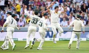 Pat Cummins of Australia celebrates with teammates after dismissing England captain Joe Root.