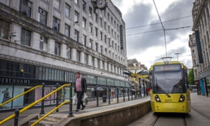 A tram at a stop in Manchester city centre earlier this month.