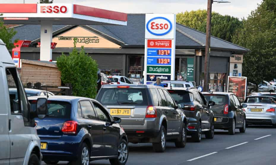 Cars queue for petrol in Harleston, Norfolk, as food and fuel supply chains are hit by the HGV driver shortage.