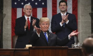 Donald Trump delivers his first State of the Union address on 30 January 2018 in Washington, as Vice President Mike Pence and House Speaker Paul Ryan applaud.