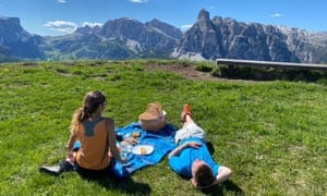 couple having picnic with mountain views