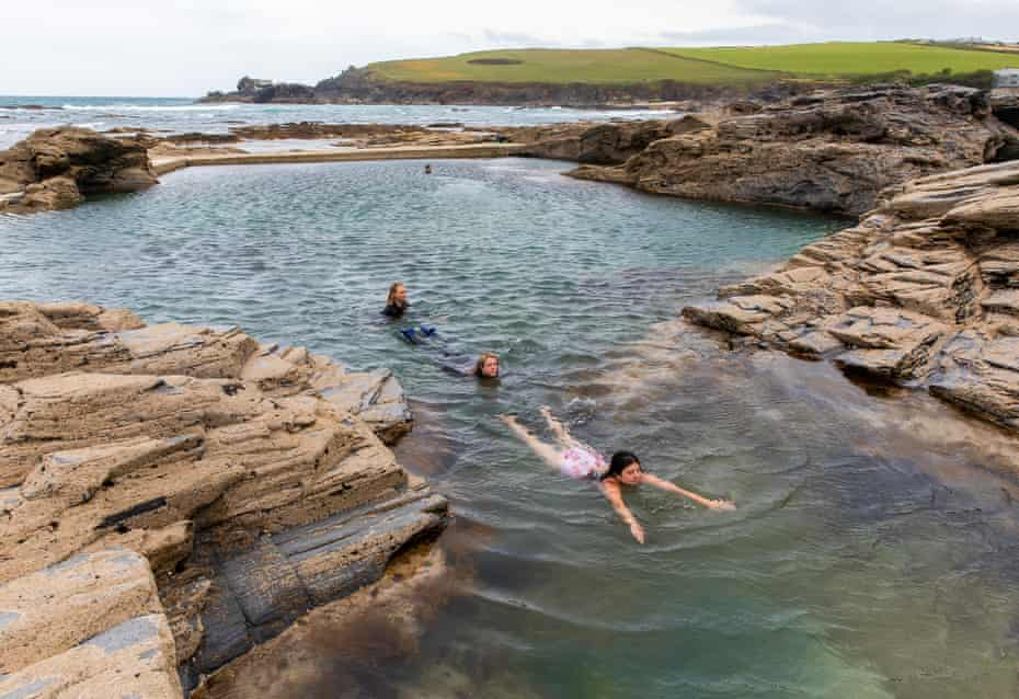 """People taking part in the Outdoor Swimming Society's """"longest swim on the longest day"""" event at Trevone ocean pool in Cornwall"""