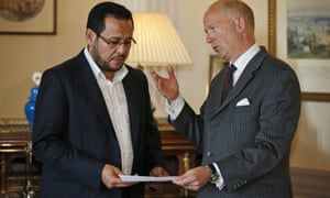 Dominick Chilcott, right, Britain's ambassador to Turkey, hands over a letter of apology from the UK government to Abdel Hakim Belhaj.