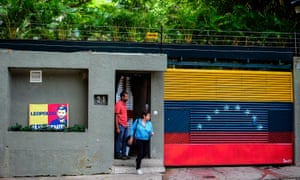 A woman leaves the house of Venezuelan opposition leader Leopoldo Lopez in Caracas, just hours after he was taken away from his home by the intelligence service.