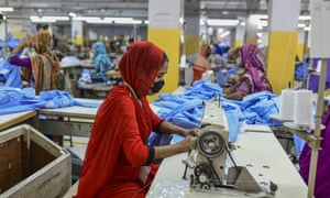 Workers return to a garment factory in Dhaka, Bangladesh, after the government eased coronavirus restrictions.