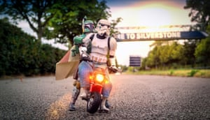 A stormtrooper gives Boba Fett a ride on his motorcycle at Silverstone.