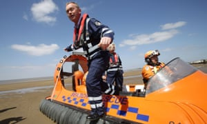 Tim Farron exits a rescue hovercraft during a visit to Burnham-on-Sea