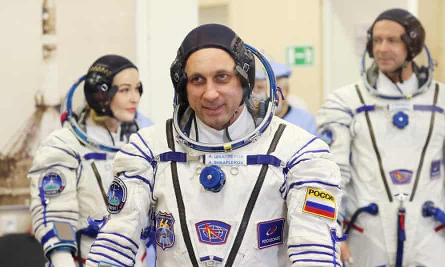 Yulia Peresild, Anton Shkaplerov and Klim Shipenko in their space suits prior to launch.