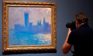 A photographer takes a picture of the Houses of Parliament by French artist Claude Monet.