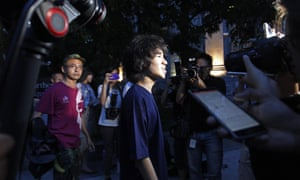 Singapore 16 year old Amos Yee Pang Sang surrounded by journalists as he leaves the State Court after being found guilty on three charges of attacking Christianity, transmitting an obscene image, and making an online video that insulted the late Lee Kuan Yew