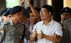 Detained Reuters journalists Wa Lone and Kyaw Soe Oo arrive at court in Yangon, Myanmar in August.