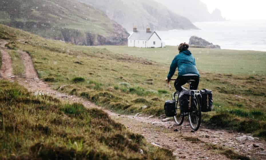 Bike to the bothy … a cyclist approaching Kearvaig Bay, Scotland.