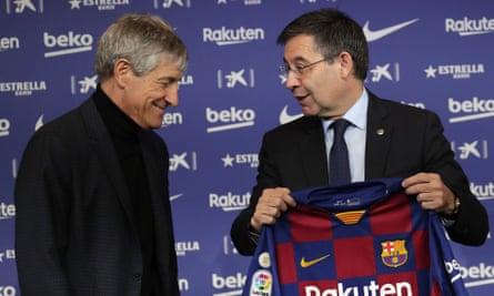 Barcelona's president Josep Maria Bartomeu holds a club shirt.
