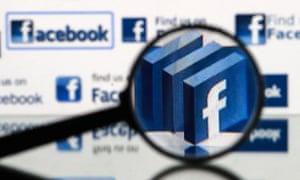facebook logo under a magnifying glass