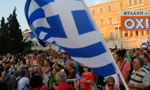 Supporters of the NO vote in the upcoming referendum hold a banner with colors of the Greek flag reading ''NO, OXI'' during a rally at Syntagma.