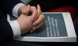 Man's hands rest on Brexit documents