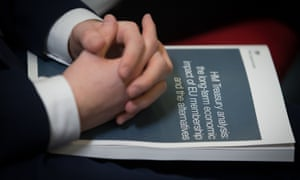 Hands folded on the Treasury report