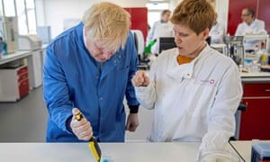Britain's Prime Minister Boris Johnson visits to the Mologic Laboratory in the Bedford technology Park, north of London.