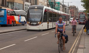 A tram and cyclists on Princes Street in Edinburgh