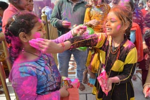 Children have fun with the powder as they celebrate at a temple in Amritsar