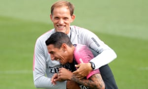 Thomas Tuchel, here sharing a joke with Ángel Di María, took over as PSG's manager this summer and starts his Champions League campaign at Anfield.