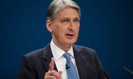 Philip Hammond gestures at Conservative party conference