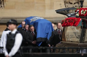 PC Keith Palmer's coffin is loaded into a hearse after leaving the Chapel of St Mary Undercroft in the Palace of Westminster