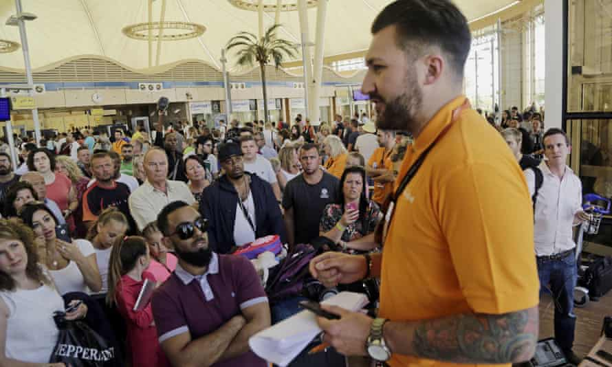 An easyJet employee talks to stranded tourists waiting at the airport to be evacuated from Sharm el-Sheik.