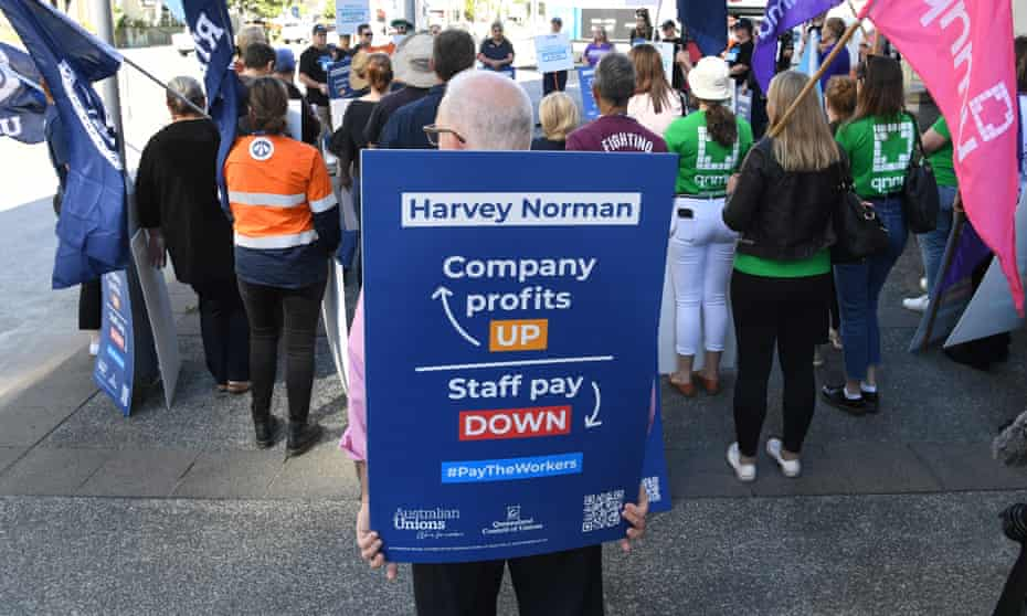 Workers protesting about pay outside Harvey Norman at Fortitude Valley in Brisbane